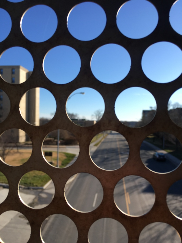 Street view through fence.
