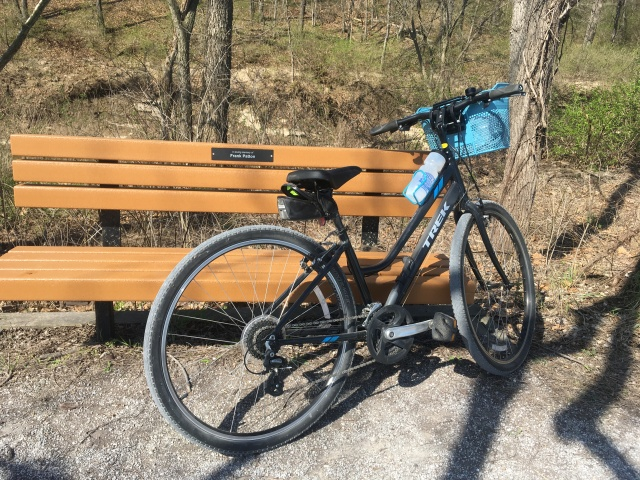 Bicycle propped at bench